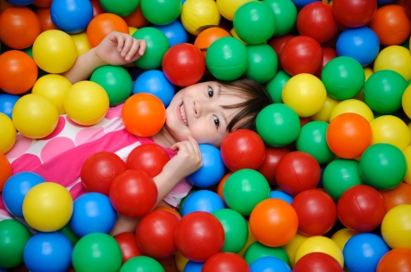 Girl in a ball pool - Special Needs Essentials