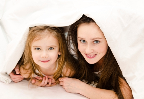 Mother and daughter under blanket - Special Needs Essentials
