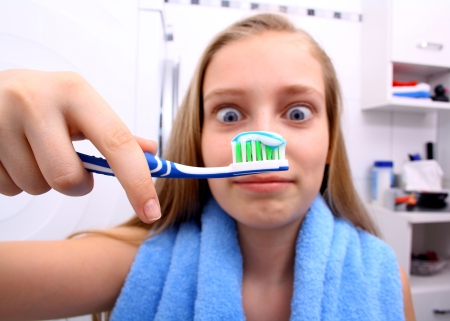 Blonde girl brushing teeth - Special Needs Essentials
